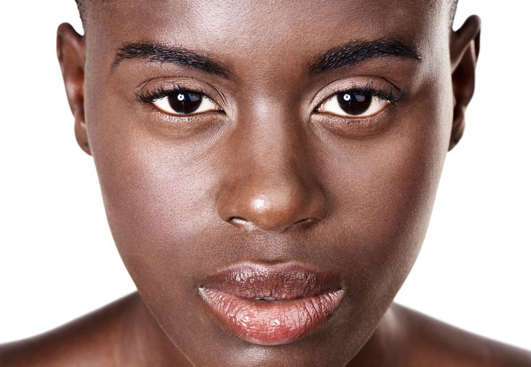 Close-up of black woman with smooth, clear skin
