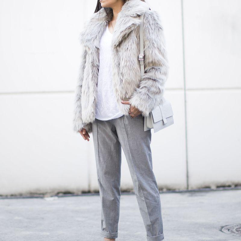 685dedb644b84 Woman in grey fur coat and grey trousers. Fashion Landscape