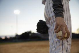 Close up baseball pitcher holding baseball