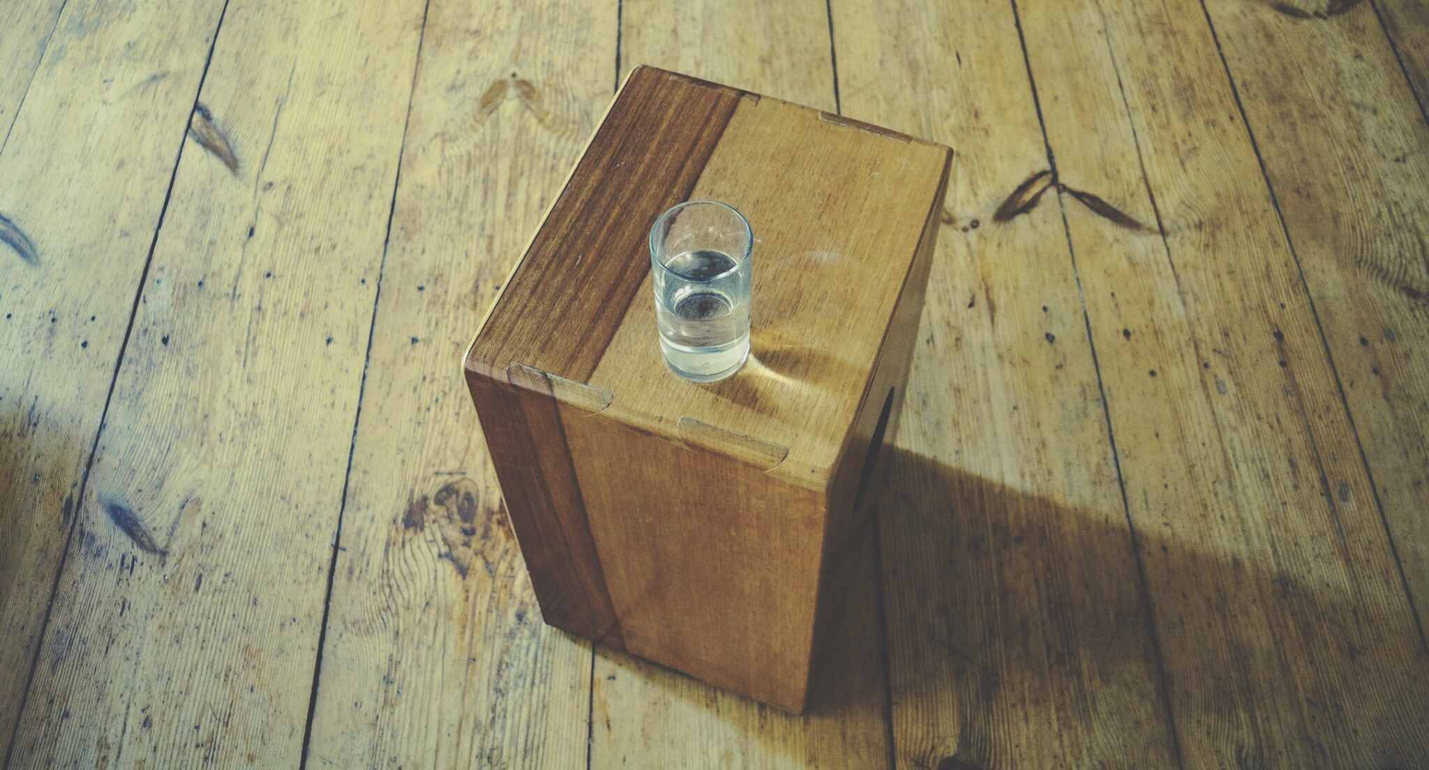 High Angle View Of Drinking Glass On Wooden Box