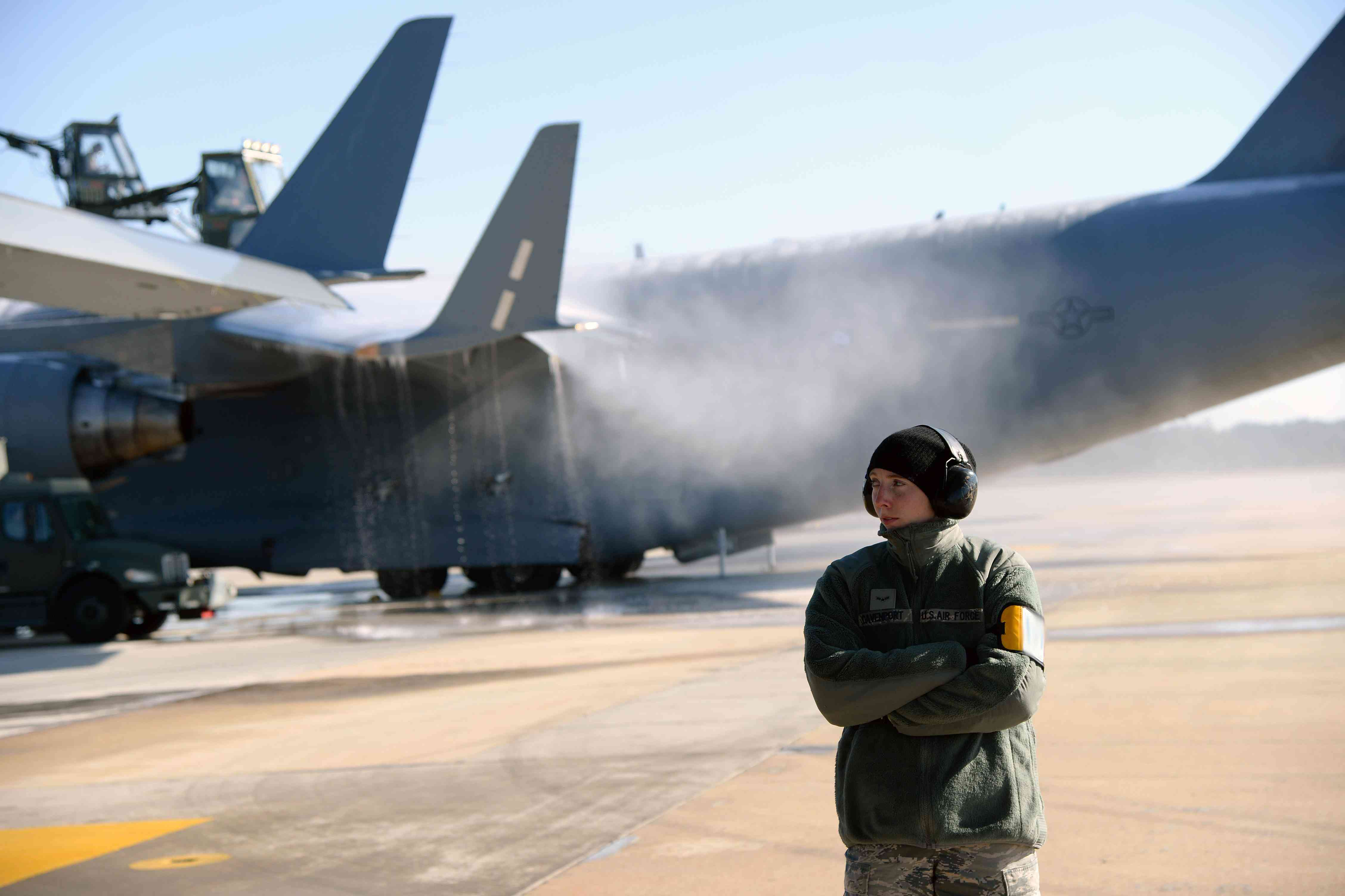 Air Force member standing in front of planes at Pope AFB