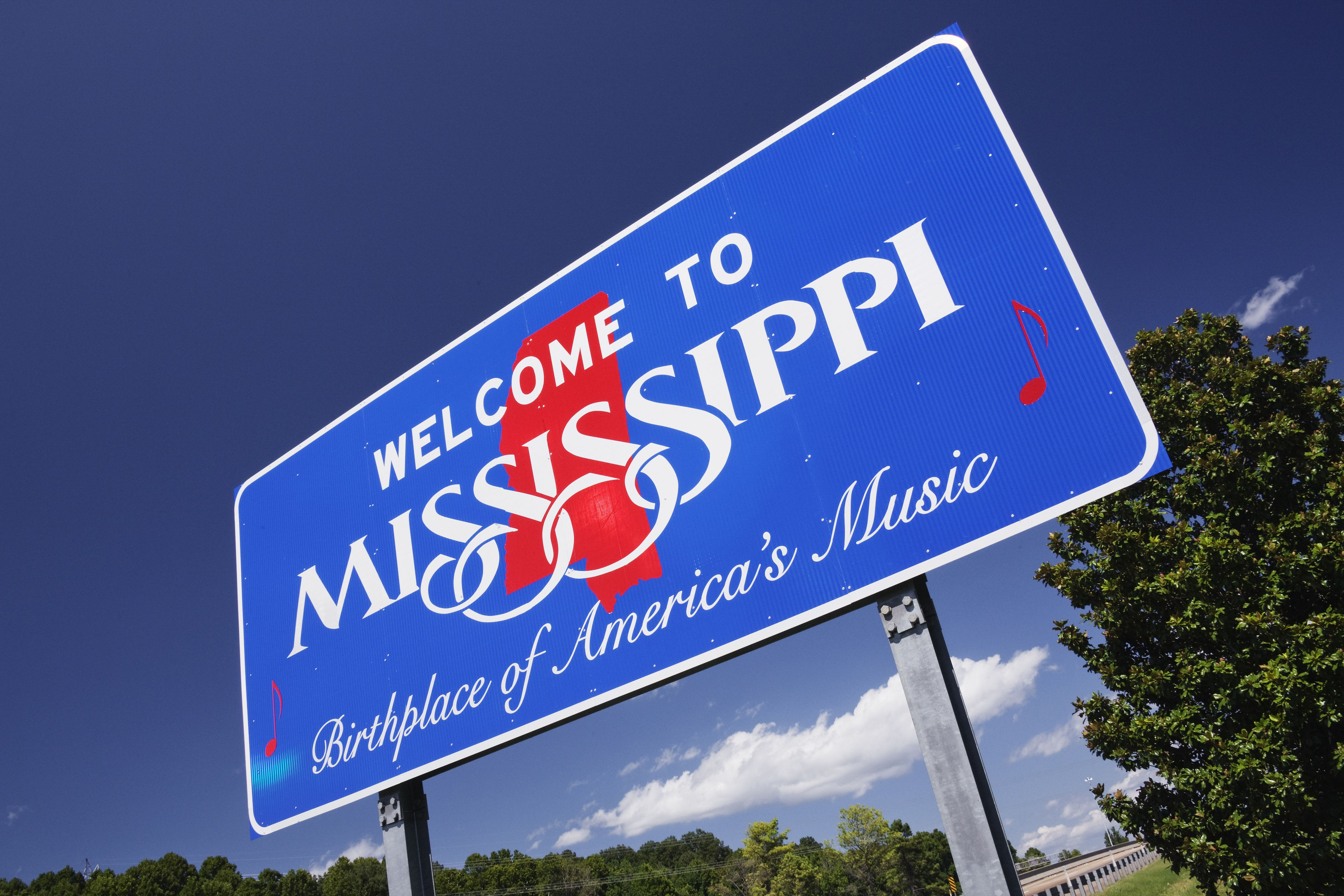 Low angle view of Welcome to Mississippi sign, Natchez, Mississippi, United States