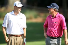 Bill Haas talks with his father Jay Haas during a practice round prior to the start of the 2010 Players Championship