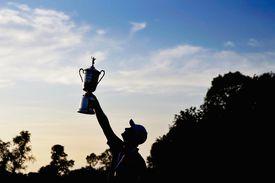 Justin Rose holds the US Open trophy aloft