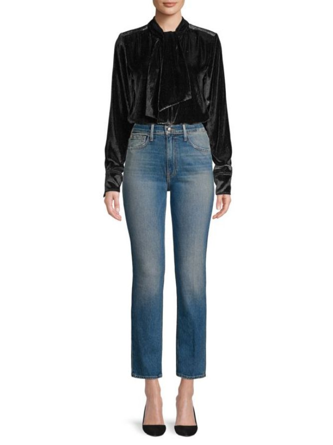 307a967ac6 Dinner Party Outfit. Woman in jeans and velvet shirt