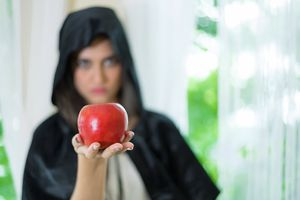 Young beautiful woman with red apple