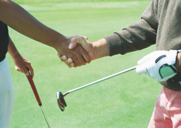 Golfers shading hands