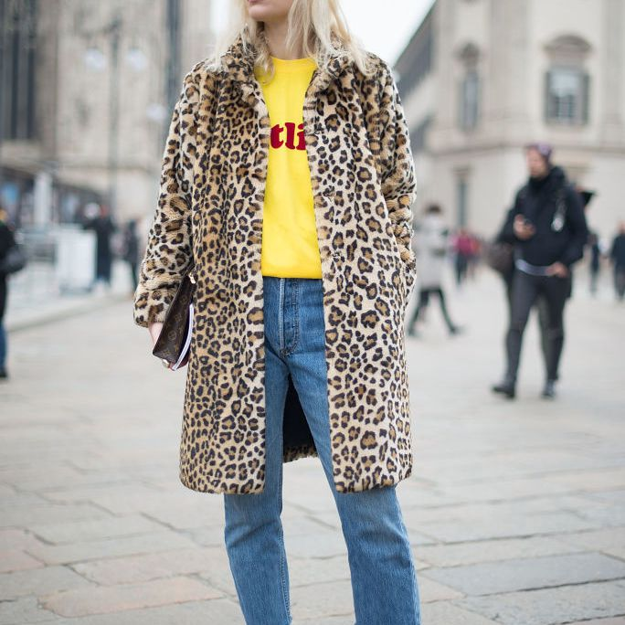 Street style in leopard print coat and raw hem jeans
