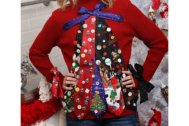A woman wearing an ugly Christmas sweater made out of ties