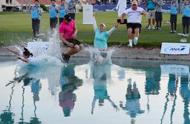 Brittany Lincicome jumps in the water with from left to right, her caddie Missy Pederson, her fianc Dewald Gouws and her father Tom Lincicome after winning the ANA Inspiration on the Dinah Shore Tournament Course at Mission Hills Country Club on April 5, 2015 in Rancho Mirage, California.