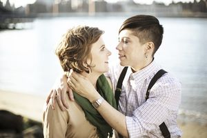 Lesbian couple embracing in Brooklyn, NY outside