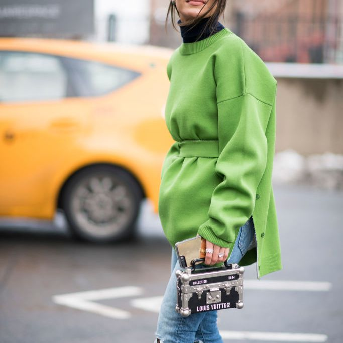 Street style woman in jeans and green top