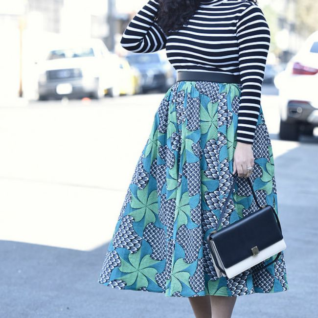 Woman in striped top and floral skirt