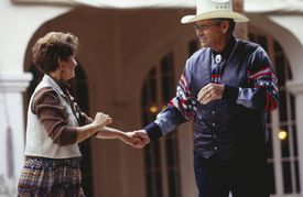 Couple square dancing outdoors