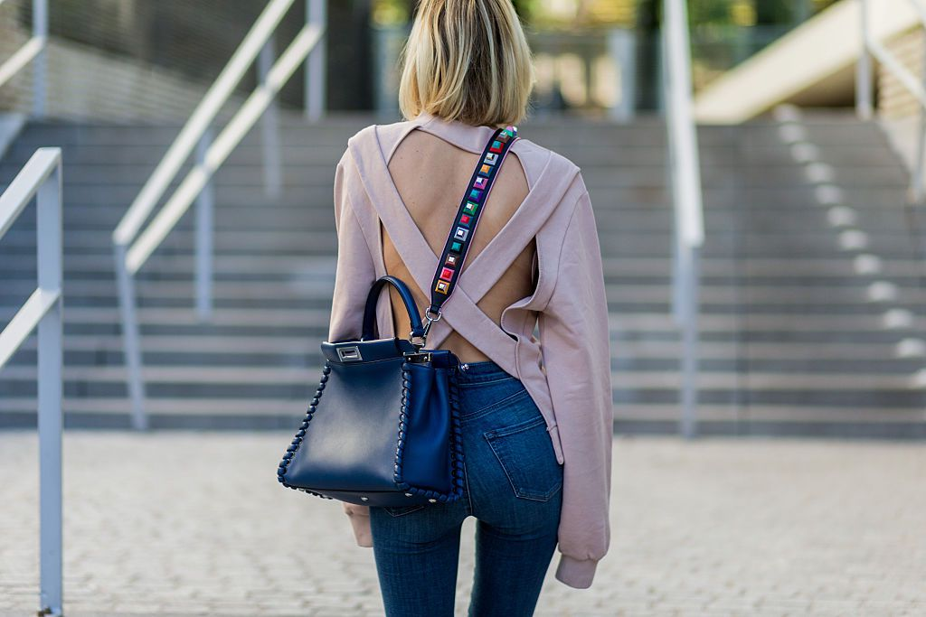 Rear view of woman in jeans