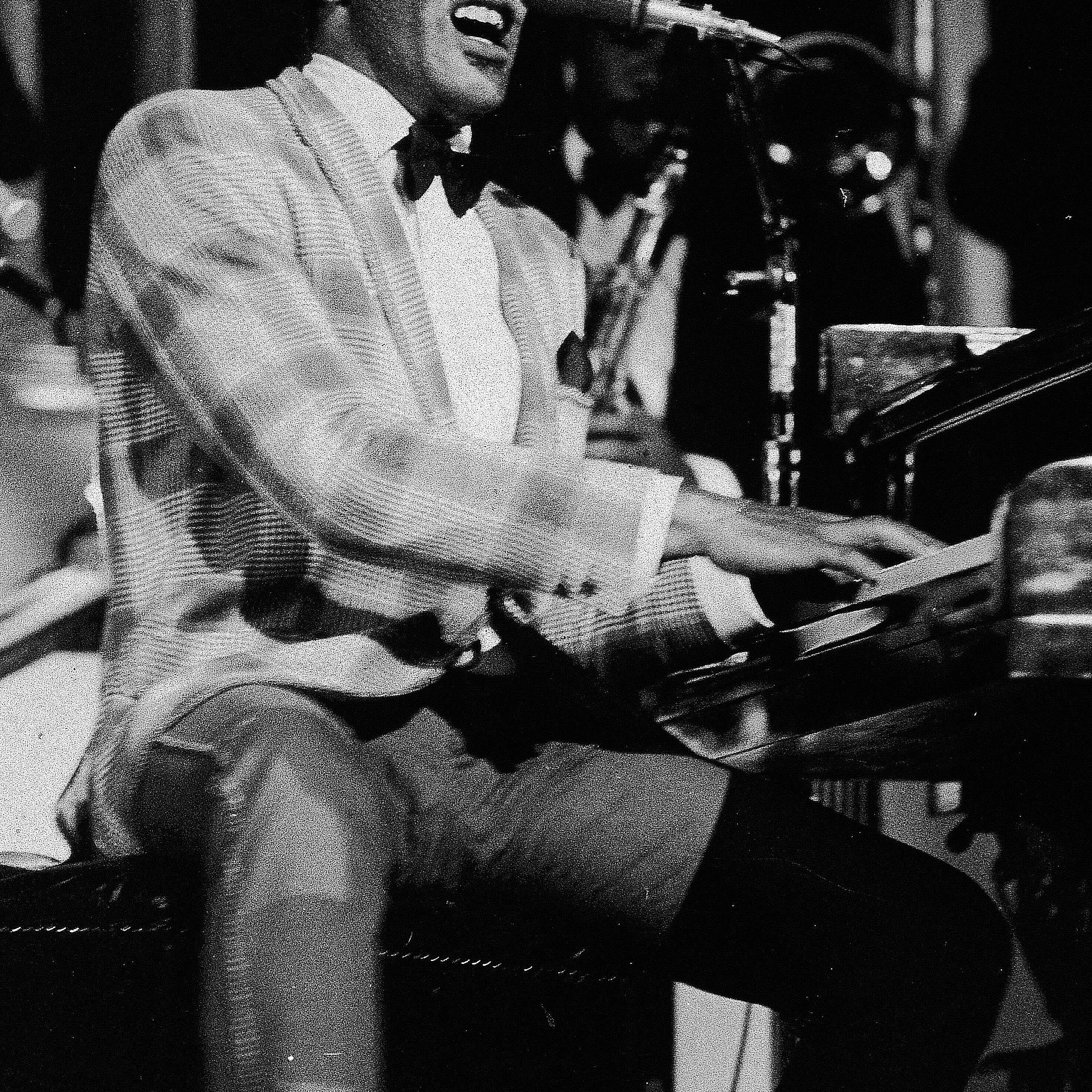 Ray Charles singing during a performance