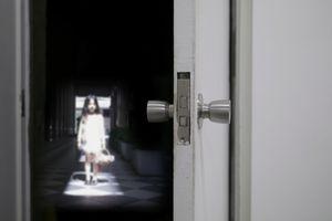 Girl on doorway