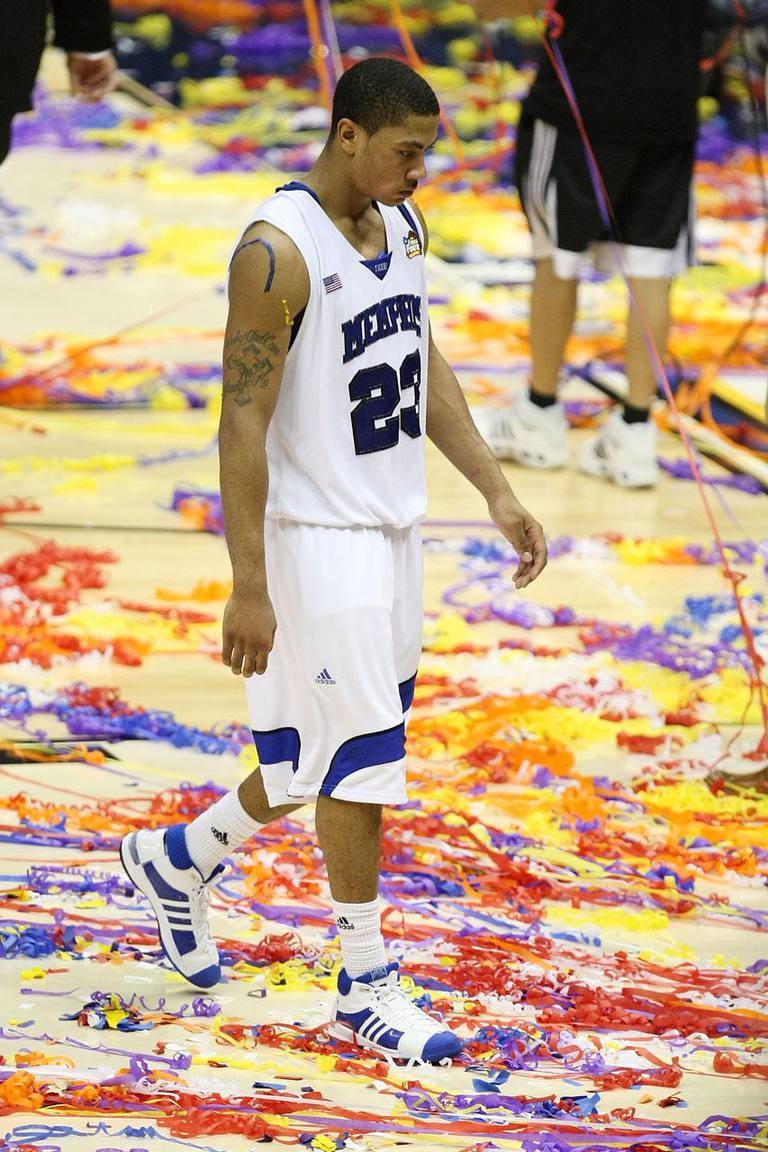 SAN ANTONIO - APRIL 07: Derrick Rose #23 of the Memphis Tigers walks off the court after losing to the Kansas Jayhawks 75-68 in overtime during the 2008 NCAA Men's National Championship game at the Alamodome on April 7, 2008 in San Antonio, Texas.