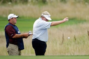 Andy Bean takes a drop after hitting out of bound at Crooked Stick Golf Club during a US Senior Open