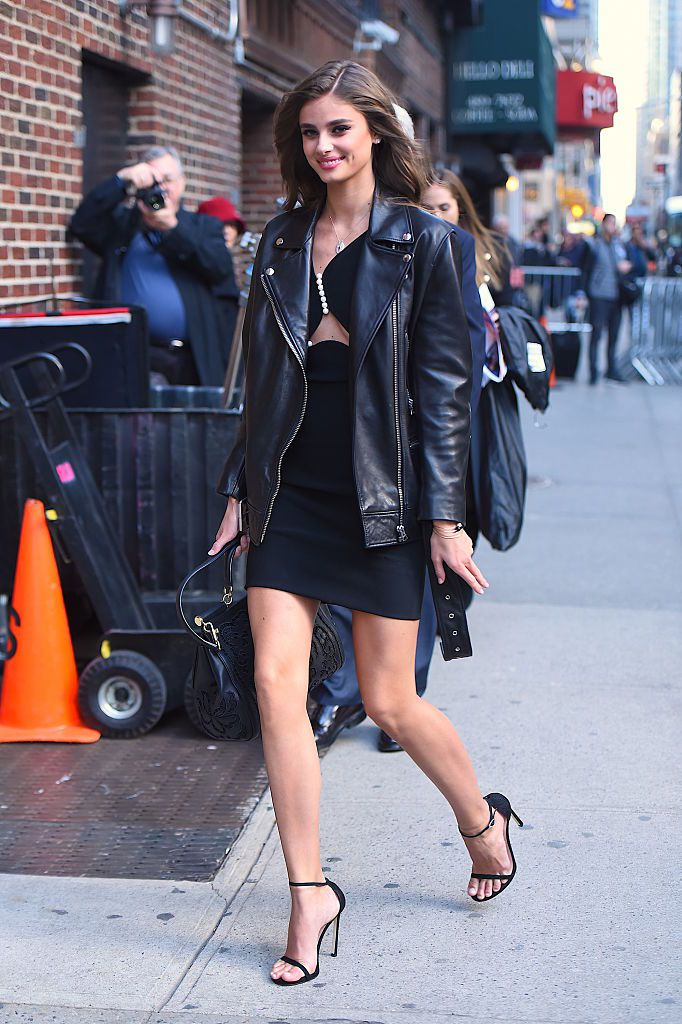 3792d89d9d5ae Model Taylor Hill in a leather jacket and black dress. Getty Images    Robert Camau