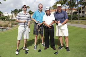 4 men posing for a pre-tournament group photo