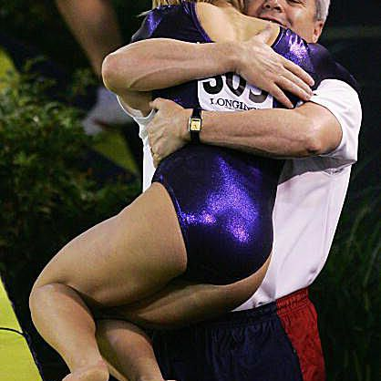 Alicia Sacramone with Mihai Brestyan at the 2005 Worlds