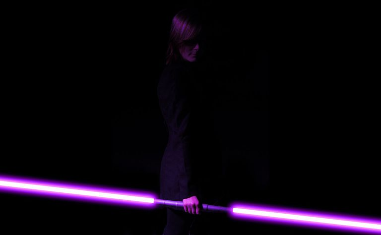 A Jedi Holds a Purple Lightsaber