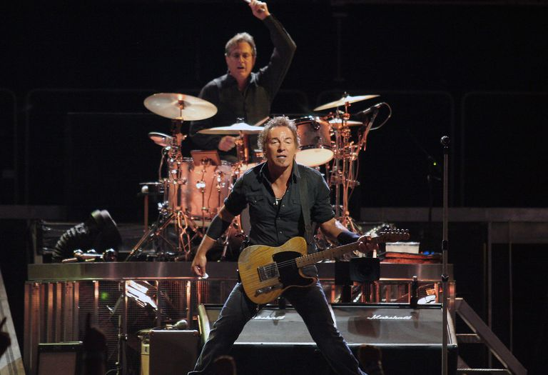 Bruce Springsteen performing live in concert.