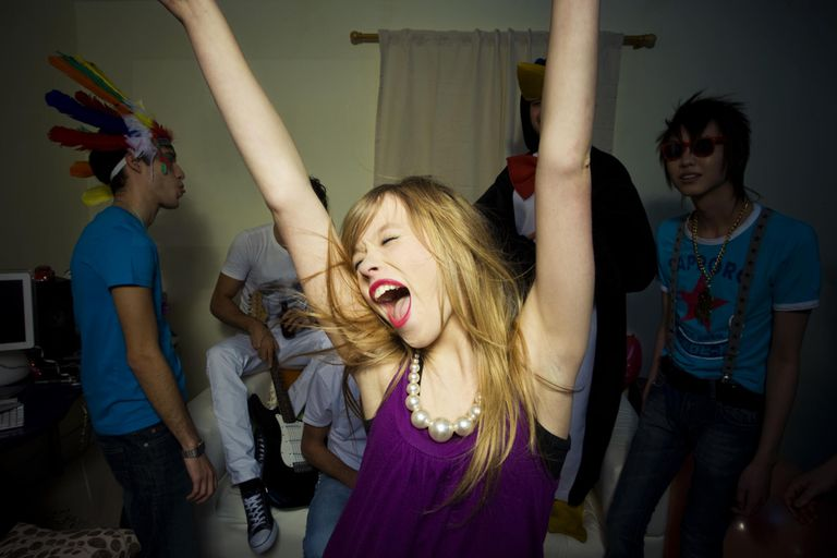 Young girl dancing at a party having fun.