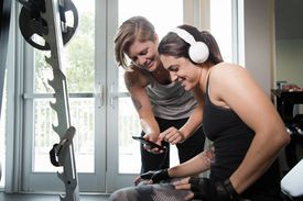 Lesbians listening to music in the gym.