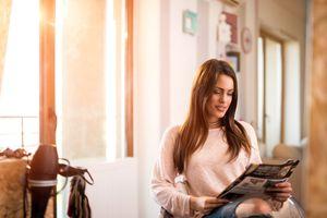 A woman reading a catalog