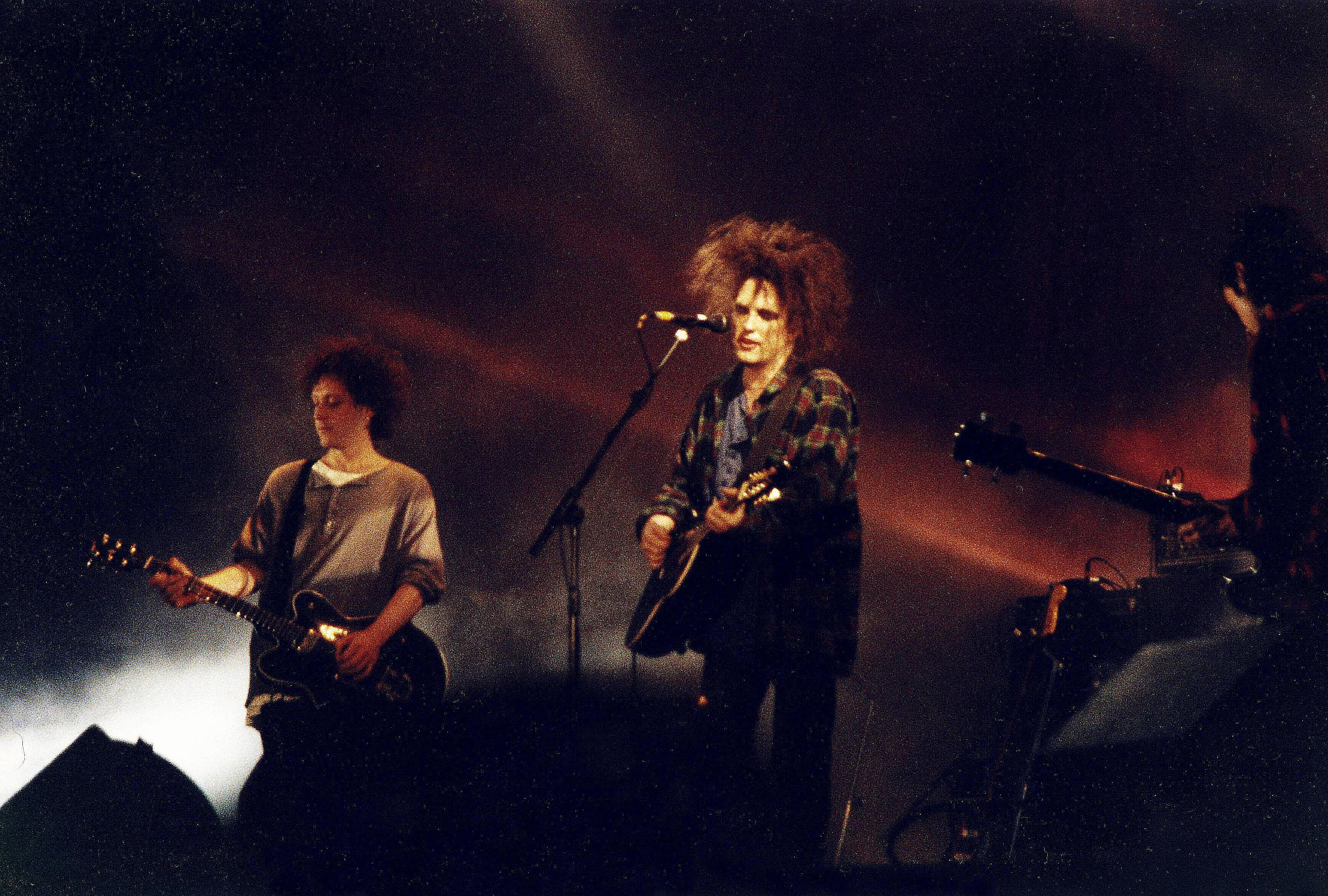 Led memorably by distinctive frontman Robert Smith (center), English alternative band The Cure performs live during the early '90s.
