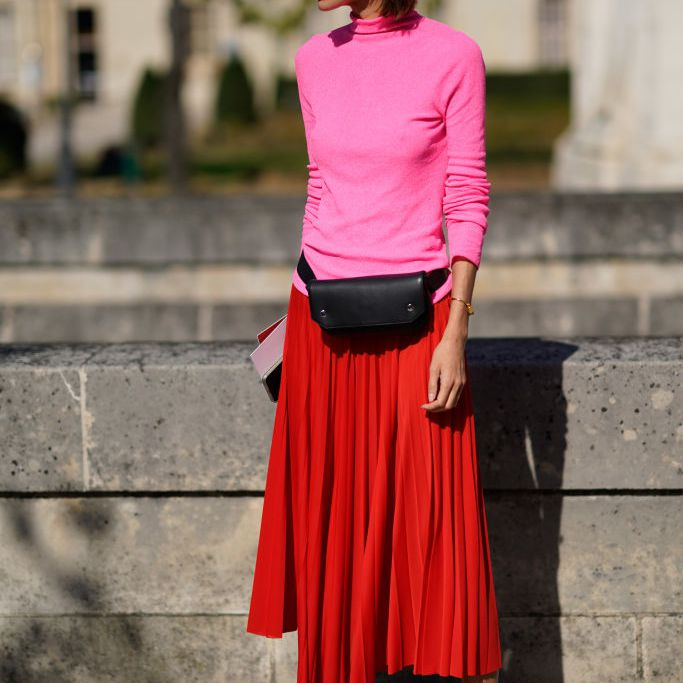 Red and pink outfit for women with a pleated skirt