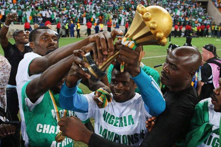 Winners of the Africa Cup hold the trophy aloft