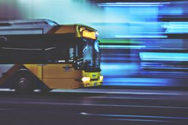 Blurred background with transit bus driving