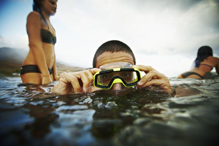 Teenage boy with diving mask in ocean