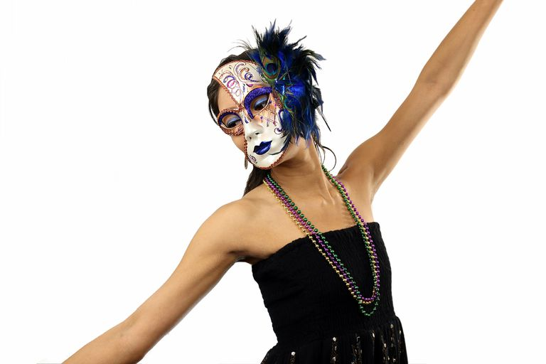 Woman wearing masquerade mask dancing