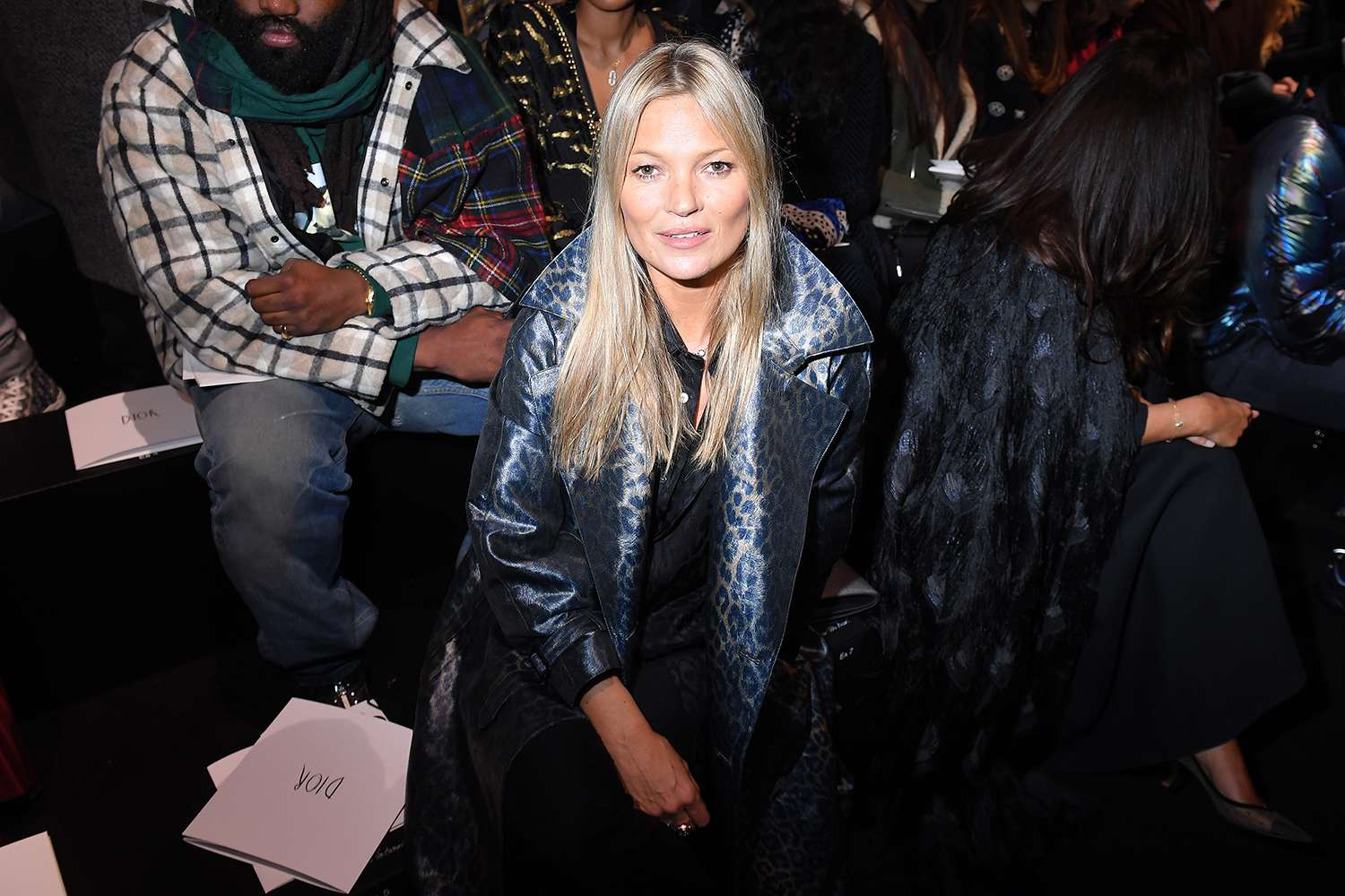 Kate Moss in the audience of a Dior fashion show.