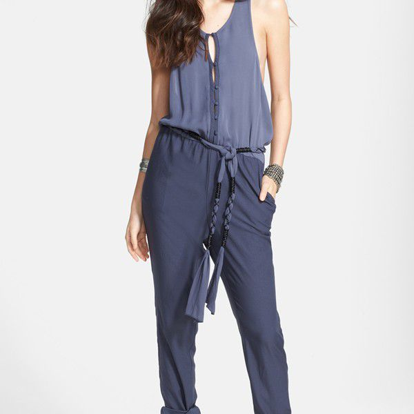 2eadb3f99b9d Woman in flat black boots and two-toned blue, loose-fitting jumpsuit with