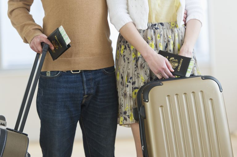 USA, New Jersey, Jersey City, Close up of couple with luggage and passports