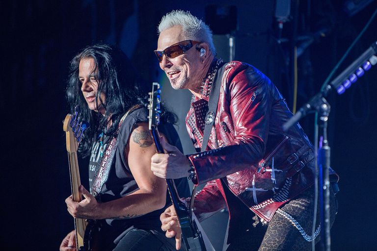 Pawel Maciwoda (L) and Rudolf Schenker of Scorpions perform on stage at FivePoint Amphitheatre on September 2, 2018 in Irvine, California.