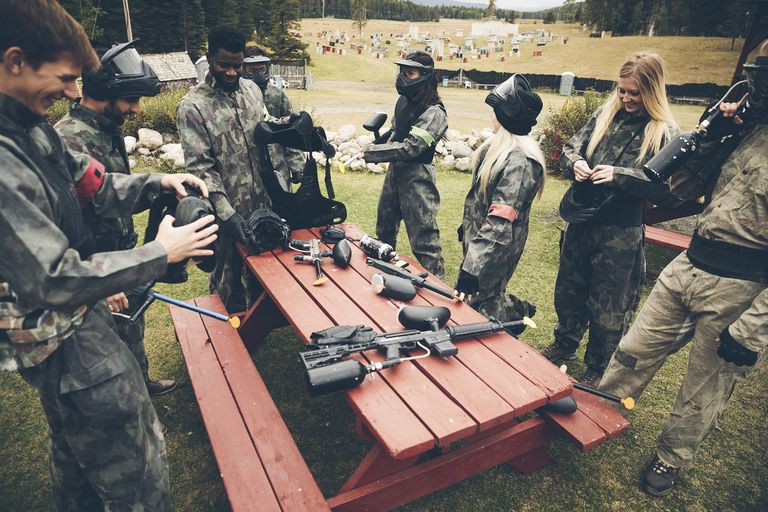 Friends Preparing Equipment for Paintballing
