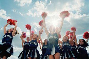 young cheerleaders mid-cheer
