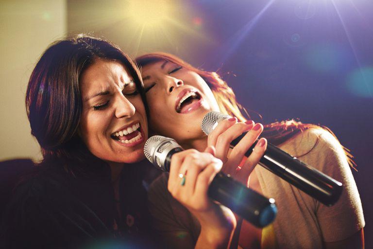 Two women singing karaoke