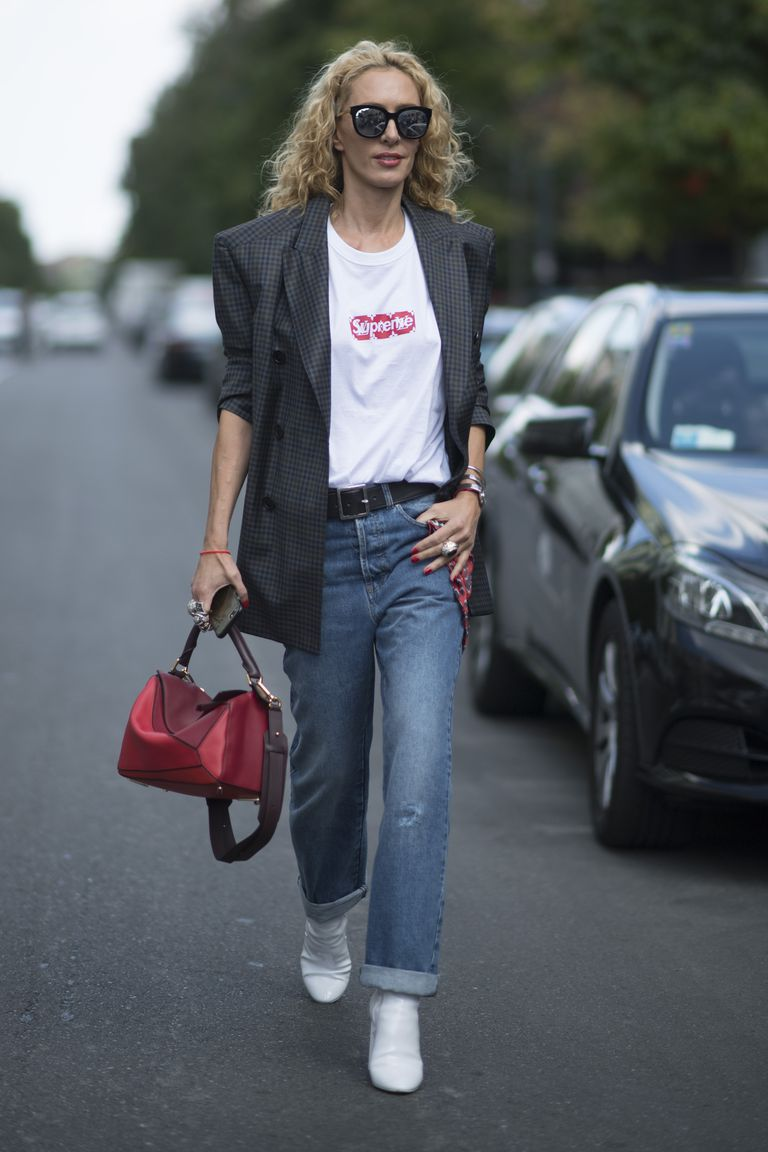 3a656bfcc0 Woman in straight leg jeans and blazer and white boots