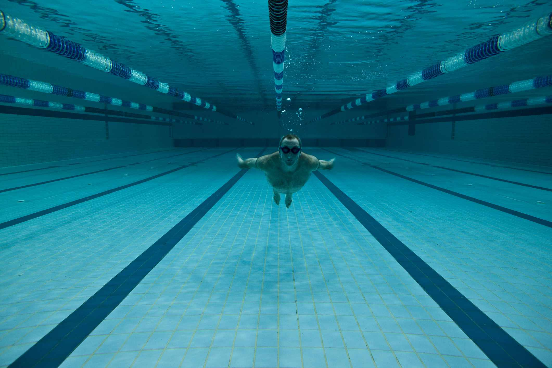 man in olympic size pool