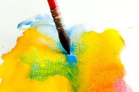 Variegated wash in watercolor, with red, blue, and yellow