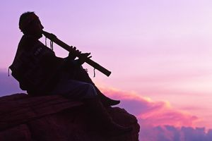 Navajo flute player near Cathedral Canyon at sunset