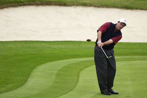 Phil Mickelson of the USA chips on the 18th green during the afternoon foursome matches on the first day of the 2002 Ryder Cup
