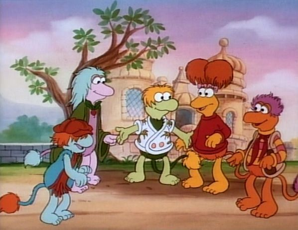 The characters from Fraggle Rock standing in half circle together.